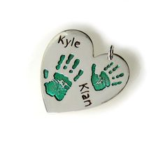 Silver handprint charm with green enamel