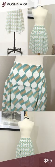ANTHROPOLOGIE GIRLS FROM SAVOY SILK SKIRT ANTHROPOLOGIE GIRLS FROM SAVOY GEOMETRIC SWIRLS OF SHERBET CASCADING DOWN THE 100% Soft Silk of the swirling paneled skirt with a slight handkerchief hemline  fully lined  Side zipper  Size two Length approx 20 waist flat 13 Prevoved in excellent condition 💜 Anthropologie Skirts