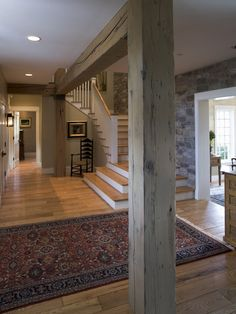 #1 - Entry . . . stone wall carries upstairs to the open kitchen-living-dining area.