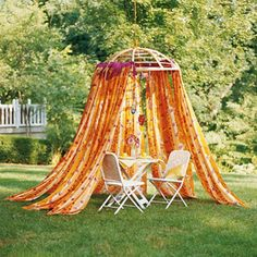 """Papasan Oasis ~ From BHG """"Instead of a tree swing, how about hanging something more grown up (but equally fun)? This inverted papasan chair base serves as an innovative place to hang curtain panels, so you can create a sweet, shaded garden getaway. Outdoor Rooms, Outdoor Fun, Outdoor Gardens, Outdoor Living, Outdoor Decor, Canopy Frame, Canvas Canopy, Futon Frame, Metal Canopy"""