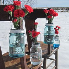 carnations in mason jar with custom wire-mesh lids (red carnations in blue tinted mason jars)