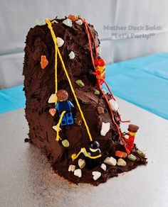 made the cake using chocolate cream cheese frosting, chocolate rocks, LEGO men and some string.