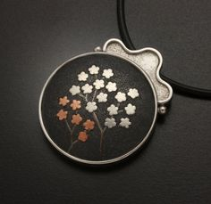 Small flowers copper and silver Keum boo pendant by KAZNESQ, $200.00