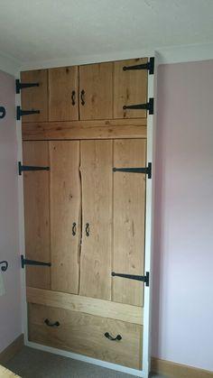 Oak ledged waney edge finish doors for a built in wardrobe Www.periodoakbeams.co.uk.