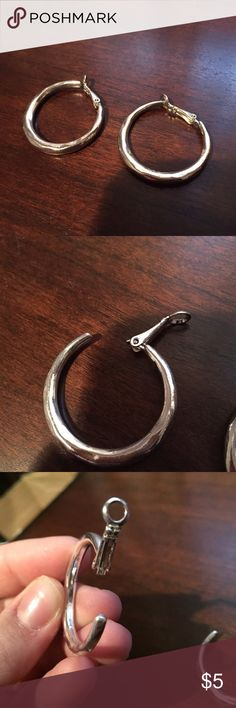 NWOT Small Silver Hoop Clip-on earrings Never been worn. Perfect for those without pierced ears. Feel free to ask questions. No trades. Jewelry Earrings