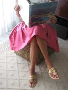 Jack Rogers Navajo sandals -- made famous by Jackie Kennedy who wore them in Palm Springs and Portofino.  That pink skirt is neat too!