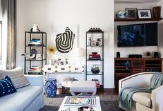 Loving the balance of the tall bookcases with floor to ceiling drapes inside Erica Chan Coffman's Pad