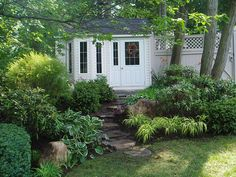 quaint garden potting shed...love the landscaping leading up to it