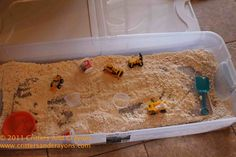 construction vehicle play in cloud dough, or could use cornmeal--Luke is dying to do this!