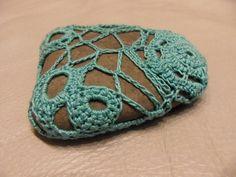 crocheted stone.