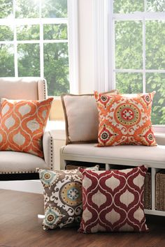 Create a spring oasis in your living room by adding accent pillows full of bright colors and bold patterns.
