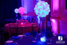 Jigsaw lamp centerpieces with pink and blue lights.