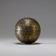 Zain Ad-din, Incense Burner or Handwarmer, 15th-16th century, gilded, pierced, and chased brass, with silver inlay