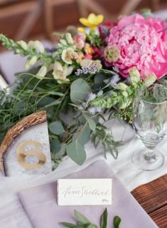Annie & Cody's Colorado Mountain Wedding at Red Sky Ranch with A Vintage Affair, Laura Murray Photography, Lale Florals, & Megan Joy Cakes featured on Brides.com