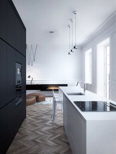 Classic herring bone patterened floor with modern kitchen.