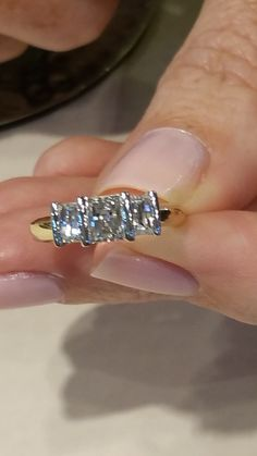 close up of millennium cut diamonds. Re modelled to a bar setting to compliment the stones and let the light in.