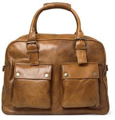 Light brown leather holdall bag from Belstaff with two handles, a detachable adjustable shoulder strap, zip fastening and one zipped internal pocket. Crafted from soft leather for a slightly worn appearance, this bag will make a seamless addition to any stylish autumn wardrobe. Shown here with a Polo Ralph Lauren jacket, Incotex sweater, J.Crew jeans and Maison Martin Margiela sneakers.