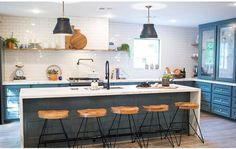 kitchen inspiration - no upper cabinets only open shelving, blue island with waterfall marble, wooden bar stools