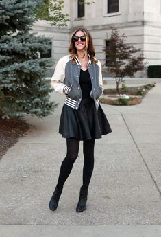 all black outfit with varsity jacket