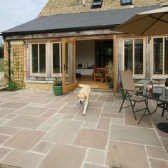 Buy pale grey brown toned Pavestone Tudor Antique Oxford tumbled sandstone paving in great value patio packs from AWBS with Free Local Delivery Sandstone Paving Slabs, Paving Stones, Flagstone, Patio Slabs, Paved Patio, Patio Stone, Tudor, Garden Paving, Sarah's Garden