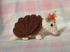 Pattern for a crocheted armadillo that can be rolled into a ball. Only palm-sized when made from DK yarn, this is a fun little creature that can be completed very quickly. Use brown or grey yarn with simple black eyes for a realistic armadillo, or go fancy with any color and embellishments for a cutesy toy look.