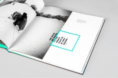 Über Alles- sideward text, uses colour & box shapes to divide page