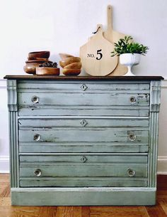 Vintage Farmhouse Chest. I hand painted this in Old Barn Milk Paints in a custom shade of blue using colors Farmstead & French Linen. This finding is very distressed & rustic. Sealed in Old Barn Beeswax. The top was refinished and sealed in Old Barn Dark Wax. Original glass knobs.