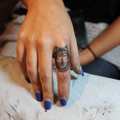 a micro wolf tattoo by Liz Markov at Bang Bang NYC