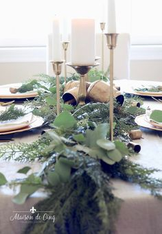 Holiday Table Setting with Cedar, Eucalyptus and Brass Bells Luckily for you, our best DIY Christmas table decorations ideas are so gorgeous, they double as conversation starters that are sure to spark some special moments between your guests.#christmastabledecorationideas #christmasdecorations #christmastablesetting #christmastabledecor #diychristmastablesettings #christmastablesettingsideas #99inspire Christmas Table Settings, Christmas Tablescapes, Christmas Table Decorations, Christmas Candles, Holiday Tables, Tree Decorations, Nordic Christmas, Christmas Holidays, White Christmas