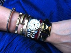 bangle from India, gold wrapped bangle, Giles & Bro railroad spike, Cartier Love, Sydney Evan baby diamond tennis bracelet, Rolex watch, Cartier string, Hermes Medor watch