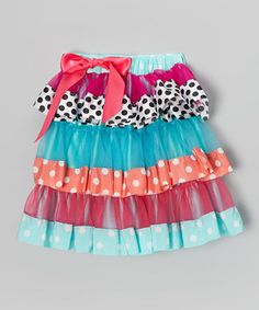 Every girl loves to twirl, and this vibrant skirt will make every pirouette twice as nice. With a peppy pattern, satin trim and endless ruffles, it's simply tons of fun.