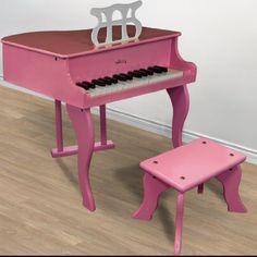 """Pink Childs Wood Toy Grand Piano with Bench Kids Piano 30 Key by Sky Enterprise USA. $79.95. This 30 key piano is ideal for children. Its """"baby grand"""" design makes a great accent to your child's room. Now you can nurture your child's interest in music without ruining your expensive instruments.   FEATURES: Pink Wood finish; 30 great sounding keys; Includes matching wood bench; Includes music holder; Perfect for kids ages 1 to 7; Dimensions Piano; 20"""" H X 20"""" W X 17"""" L; Dimensions..."""