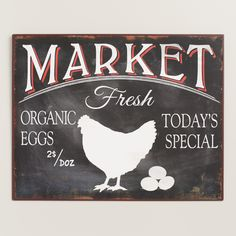 A charming addition to the kitchen, this quaint metal sign is a reminder of the fresh eggs available at local farmers markets.