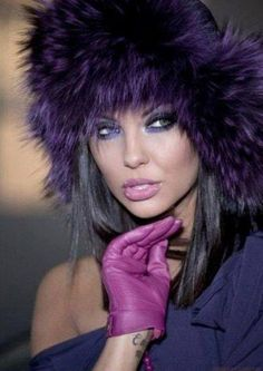 Plum colored leather gloves with deep purple furry hat