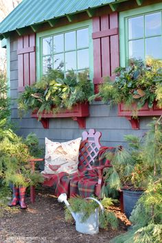 Sprucing up the Potting Shed window boxes for Christmas with greenery, pine cones and rusty metal jingle bell garland | homeiswheretheboatis.net #PottingShed #Christmas #greenery #windowboxes