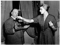 Hitchcock and Bergman winding yarn.