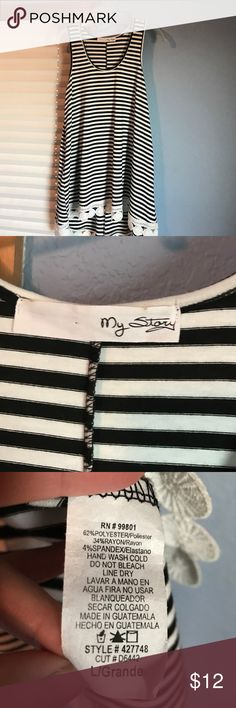 Black and white striped tank Cute high/low striped tank.  Soft material with cute lace bottom. My Story Tops Tank Tops