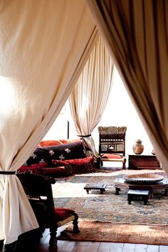 Sahara style billowing curtains, a haven from the desert sun.