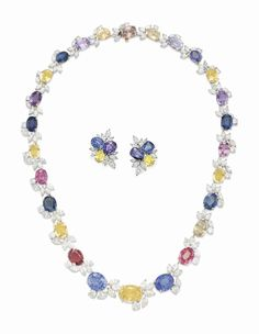 A SET OF MULTI-COLORED SAPPHIRE AND DIAMOND JEWELRY
