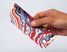 A bookmark to highlight sensations of Curious Matter paper, produced by Arjowiggins Creative Papers. designed by The Bakery design studio and printed by Generation Press.