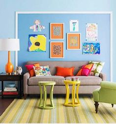 budget living room decoration ideas.  I like the framing to create a secondary space on the wall.  Kids' artwork is always a great thing to showcase