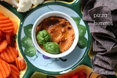 """Pizza Hummus is a fun variation on the traditional hummus. In my ever persistent pursuit to put more produce into our persons (do you like the """"P"""" alliteration?), I knew I needed to start reaching reaching more for veggies for our family's snack attacks. Honestly, when I want a snack, I usually want carbs. I...Read More »"""