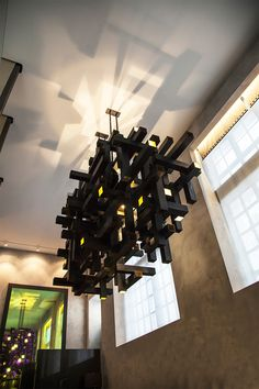 "Over the course of its construction ""3D"" was a lighting sculpture in metamorphosis, transforming from a rough casting to a bold constructivist form. Composed of 283 gold anodised extruded alloy tubes with integrated LED lighting, the structure was finished in an aged bronze patina for a private client's dining room in an elegant central London carriage house. The intricate configuration was designed to create an epic interplay between light and shadow across the ceiling."
