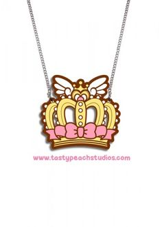 A cute gyaru princess angel wing grown necklace The charm is approx inches tall and suspended from an inch silvertone chain br br Acrylic is waterproof and scratch resistant All Tasty Peach Studios, Cartoon Tattoos, Kawaii, Angel, Crown, Accessories, Cartoons, Jewelry, Drawings