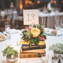 flowers and book wedding table number centerpiece ideas