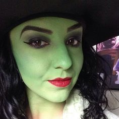 A simple green face makeup is simple but it still makes it clear that she is a witch.