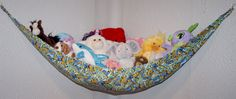 Stuffed animal hammock Cute way to keep all those stuffed animals off the floor and looking more organized