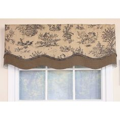The small scale toile in shades of black and cream is made into a layered valance and paired with a check border and braided trim. This valance is perfect for any sized window whether grouped, laid flat or bunched.