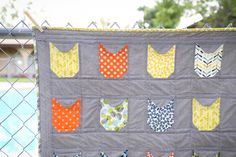 Cat Face Quilt, cats on quilts, quilts with cats, quilting with cats, kitty quilts, cloud nine fabrics, modern quilts, quilts for boys, quilts for kids, scrappy binding quilts