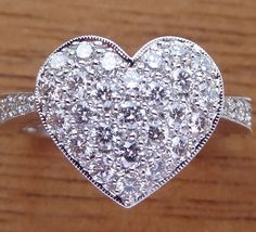 This is beautiful! But I would only want it if the band was traditional and domed instead of euro and flat. ...This pave diamond heart shape ring is hand made in 18k white gold. There are 36 Pave set side diamonds totaling .76Cts, approximately 3/4 Carat The diamonds are VS clarity and G color range.